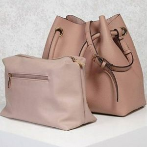Blush colored faux leather bag